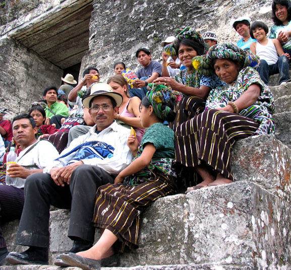 Tikal Ruins, central pyramid, Guatemalan natives in festive garb.